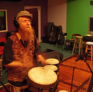 David Alderdice, studio drummer, laying conga tracks in a recording session.