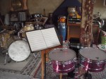 Drumset and sheet music that David uses in his continuing study of music theory.